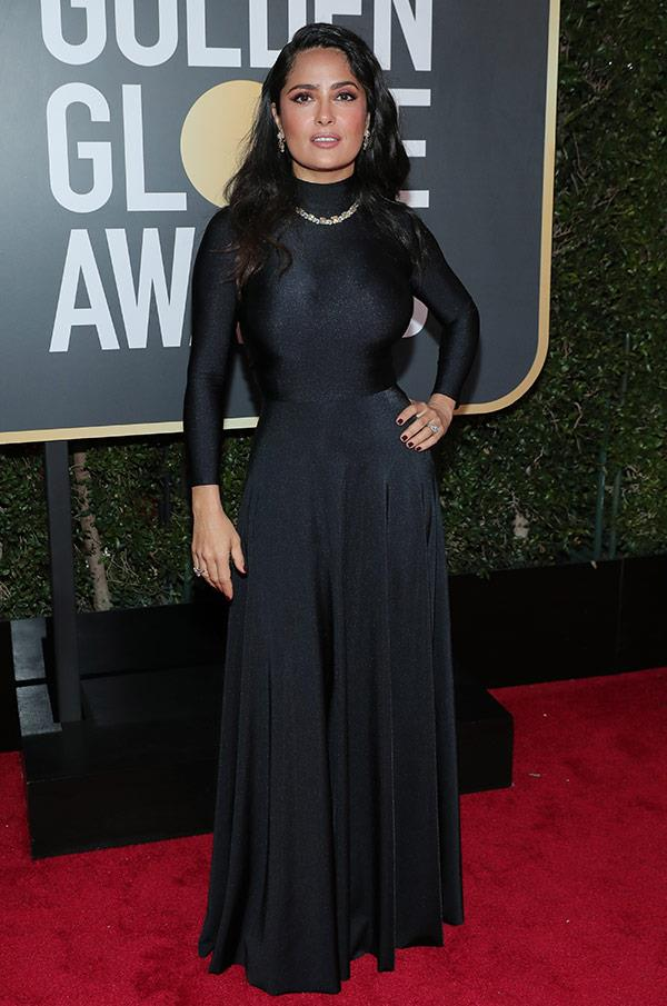 Salma Hayek sizzles in this high-neck frock.