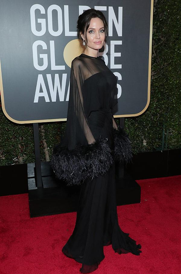 Angelia Jolie is a total vision in this long-sleeved, sheer dress. The 42-year-old will be presenting an award this evening.