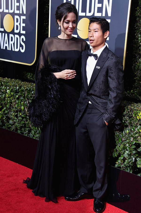 Angelina seems mighty impressed with her date, son Pax.