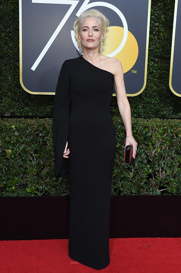 **Gillian Anderson** looks as remarkable as her Twitter page - which is covered in Time's Up posts.