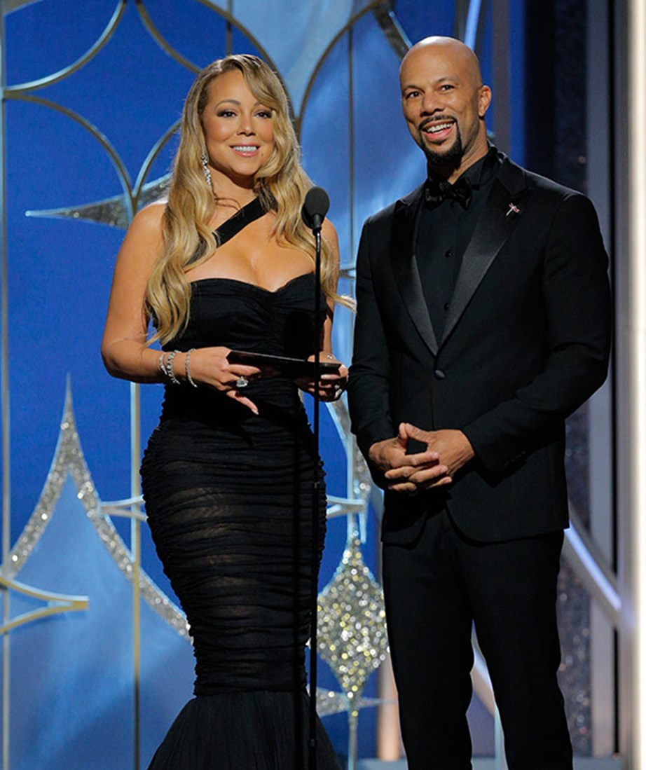 Mariah Carey flaunts her amazing slim-down as she presents an award.