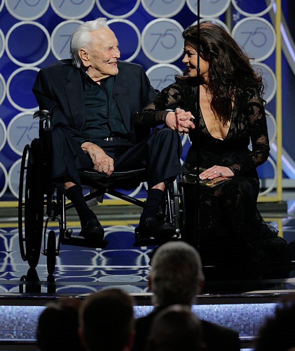 "What a moving moment! 101-year-old [Kirk Douglas presents an award](https://www.nowtolove.com.au/celebrity/celeb-news/kirk-douglas-joins-catherine-zeta-jones-at-golden-globes-44052|target=""_blank"") with daughter-in-law Catherine Zeta Jones."