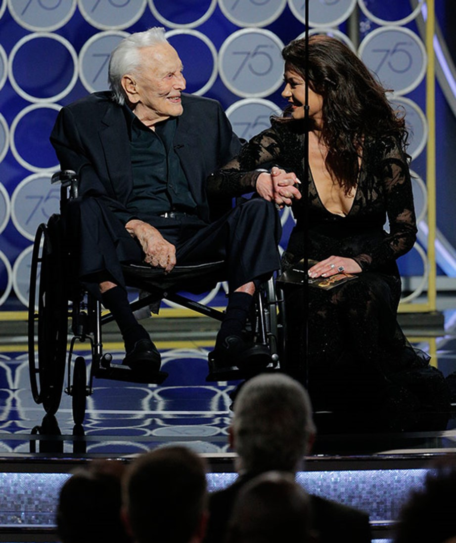 Catherine Zeta Jones on stage with her father-in-law Kirk Douglas.