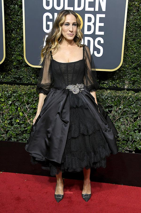 Sarah Jessica Parker wore a corseted dress with her hair hanging relaxed around her face.