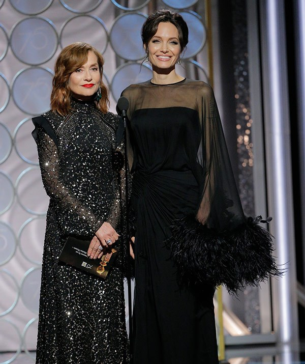 "Close call! Angelina Jolie and Isabelle Huppert introduced the nominees for Best Performance by an Actress in a Motion Picture - Drama, just a [few moments after Jennifer Aniston was on stage...](https://www.nowtolove.com.au/celebrity/celeb-news/angelina-jolie-and-jennifer-aniston-at-the-golden-globes-44008|target=""_blank"") Interestingly, Jen skipped walking the red carpet. This marks the first time Brad Pitt's love rivals have been in the same room for the first time in three years!"