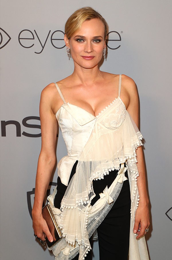 From black, to white! Diane Kruger slips into a camisole white top.