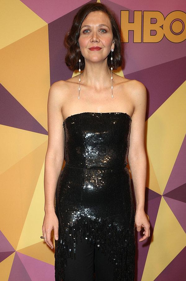 Maggie Gyllenhaal makes a dazzling entrance.