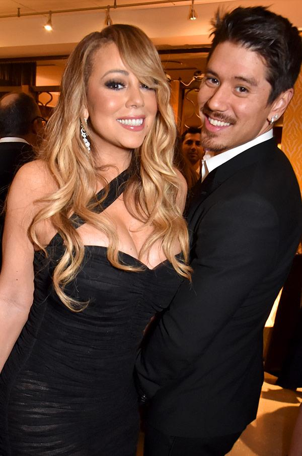 It's Queen Mariah Carey and her boyfriend, Bryan Tanaka.
