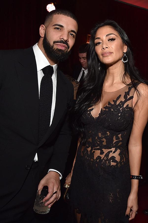 Drake cuddles up to Nicole Scherzinger.