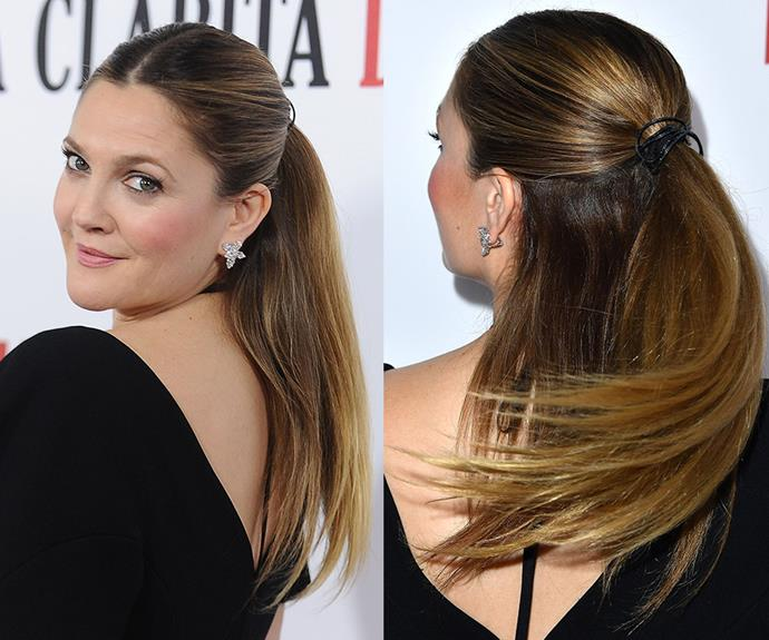 """UV rays can be harsh on hair so we tend to resort to wearing it up by the time end of summer rolls around, but with the right products you can pull off **Drew Barrymore's** smooth and shiny half ponytail style. Start by using an ultra-nourishing nourishing shampoo such as [Pantene Smooth & Sleek Shampoo](https://www.priceline.com.au/pantene-smooth-sleek-shampoo-350-ml