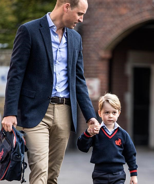 Prince George was a little hesitant as Prince William walked him into the school gates at Thomas's Battersea.