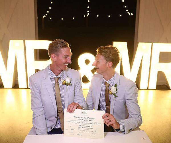 Craig Burns and Luke Sullivan married just after midnight at Summergrove Estate on the Gold Coast.