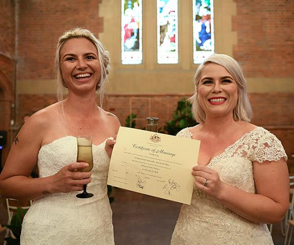 Sarah Turnbull and Rebecca Hickson pose with their Certificate of Marriage after being married in a ceremony in Newcastle, NSW.