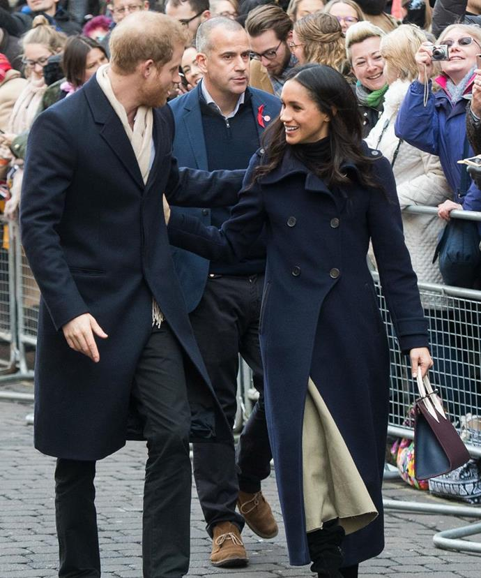 "Meghan and Harry's [first official public engagement](https://www.nowtolove.com.au/royals/british-royal-family/prince-harry-and-meghan-markles-first-royal-engagement-43305|target=""_blank"") as a couple, saw the stunning brunette embracing clean-lined basics in the most sopohisficated way. The ensemble selected by her friend and stylist Jessica Mulroney included double-breasted navy coat over a black, high-necked knit tucked into a structured tan skirt. The bag Meghan was carrying, a tote by Strathberry, sold out in 11 minutes flat!"