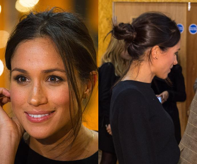 """**Meghan Markle's** messy bun works for every end-of-summer occasion: last-chance beach days, brunch dates, BBQs or even [official royal duties](https://www.nowtolove.com.au/royals/british-royal-family/prince-harry-and-meghan-markle-brixton-reprezent-1073-fm-44091