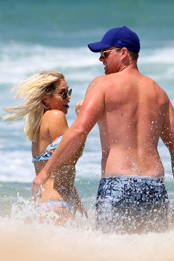 Jarrod protects his lady from the waves.