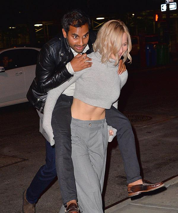 Aziz, pictured with friend Jennifer Lawrence, lives in the swanky New York area of Tribeca.