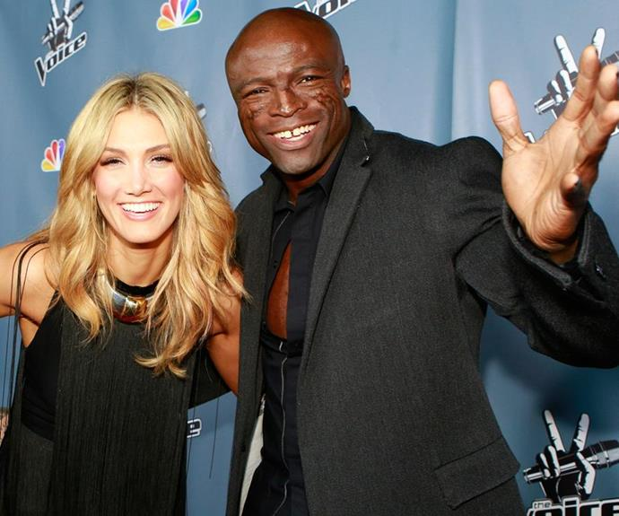 Seal, pictured with his *Voice* co-star Delta Goodrem, came under fire for attacking Oprah.