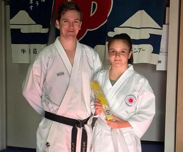 Eva receiving her yellow belt at Shobukan Martial Arts. Source: supplied