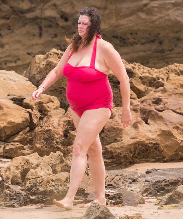 Tziporah stepped out in a red halter neck one-piece.