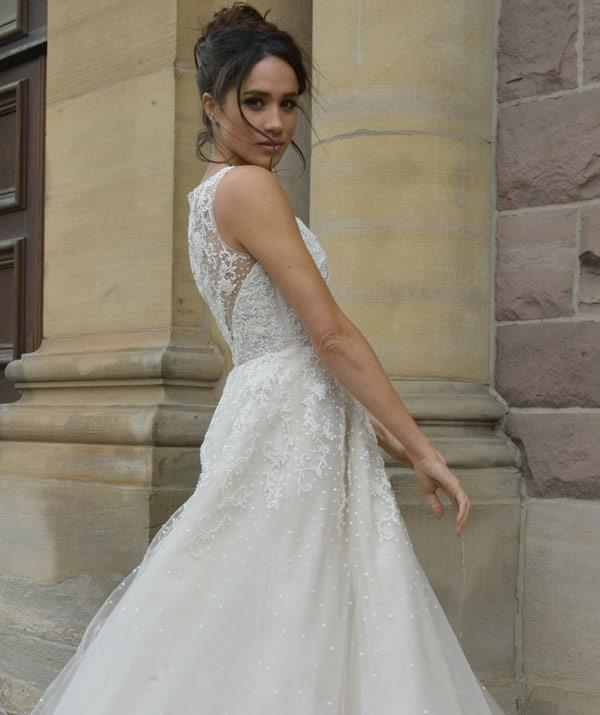 Meghan Markle's *Suits* character Rachel Zane wore a gorgeous lace gown for her wedding.