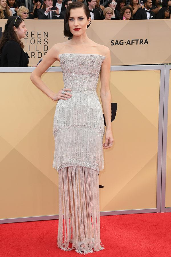 We're swooning over Allison Williams dramatic bold lip and layered silver dress.