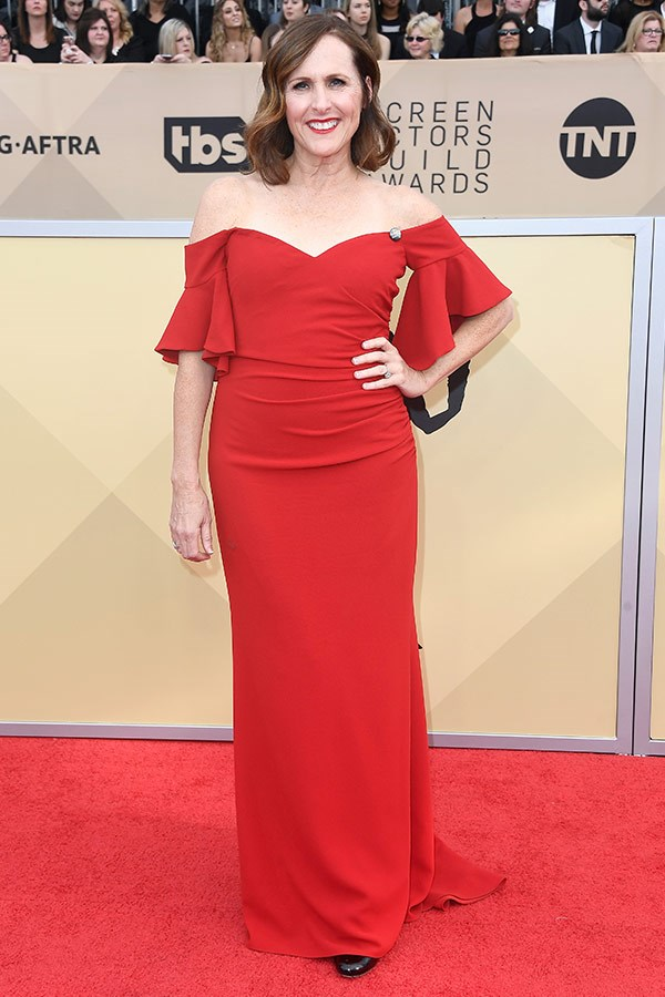 Molly Shannon's shoulder-skimming red frock is just ravishing.