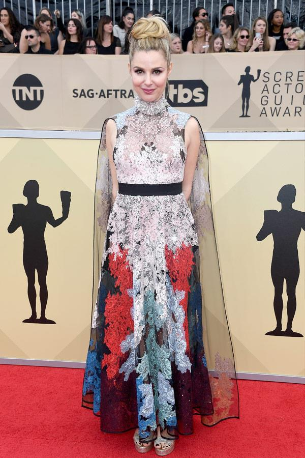 *Mad Men* stunner Cara Buono works an intricate floral cape.