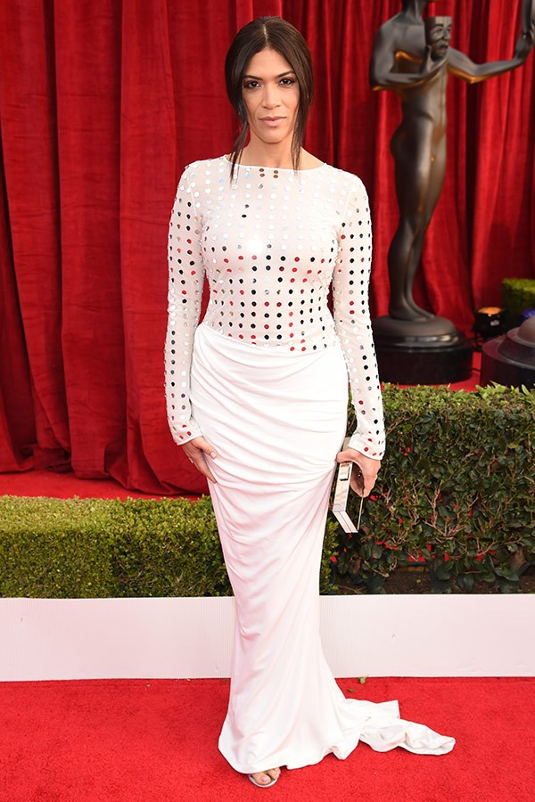 Laura accessorised her figure-hugging white gown with a metallic clutch and glowing make-up.