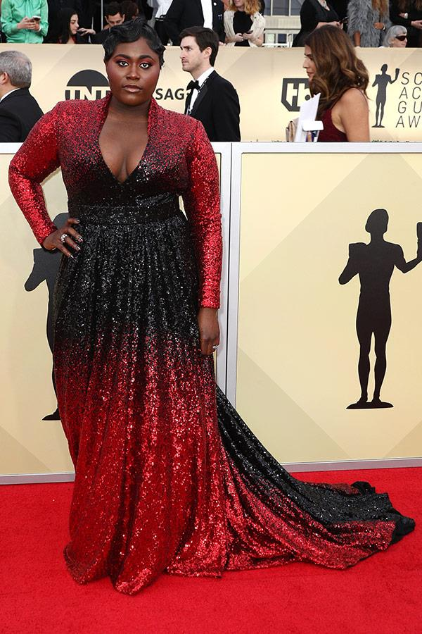 Danielle Brooks shuts down the red carpet with the ombre black and red gown.