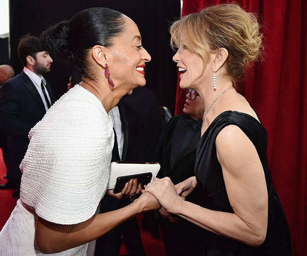 Tracee Ellis Ross and Felicity Huffman share a laugh.