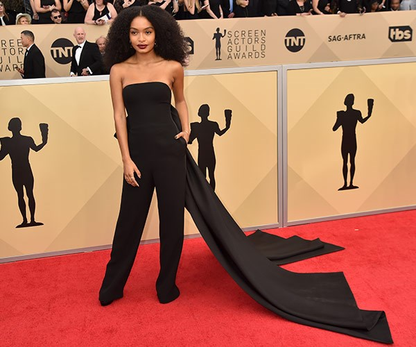 *Black-ish* star Yara Shahidi makes a dramatic entrance in this black jumpsuit with an intricate train.