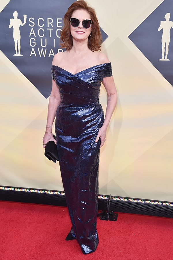 Stylish as ever, Susan Sarandon opted for a classic silhouette embellished by shimmering fabric. Oh, and her signature accessory, shades (possibly for the glitter glare?).