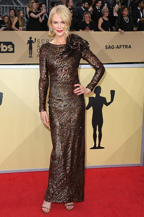 She's here! Outstanding Performance by a Female Actor in a Television Movie or Miniseries nominee Nicole Kidman channels her inner golden statue in this sparkling, long-sleeved dress by Armani Prive.