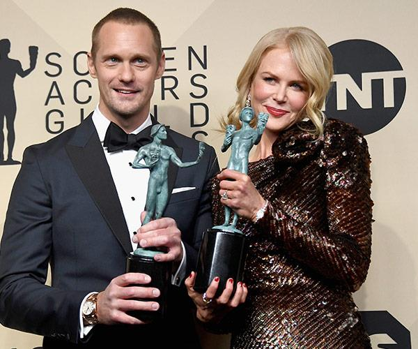 Alexander Skarsgard and his *Big Little Lies* co-star Nicole Kidman get a team snap with their shiny new toys.