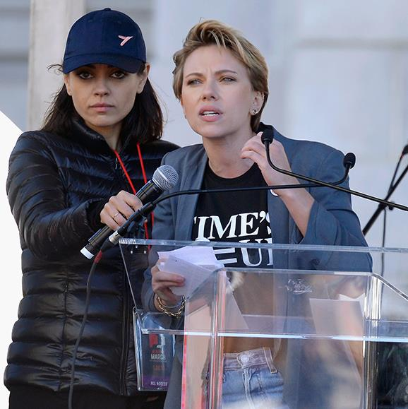 Mila Kunis supports fellow actress Scarlett Johansson as she speaks during the Women's March Los Angeles.