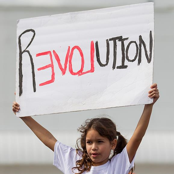 Sofia Palomo, 10, hold a clever sign during the Women's March in Miami.