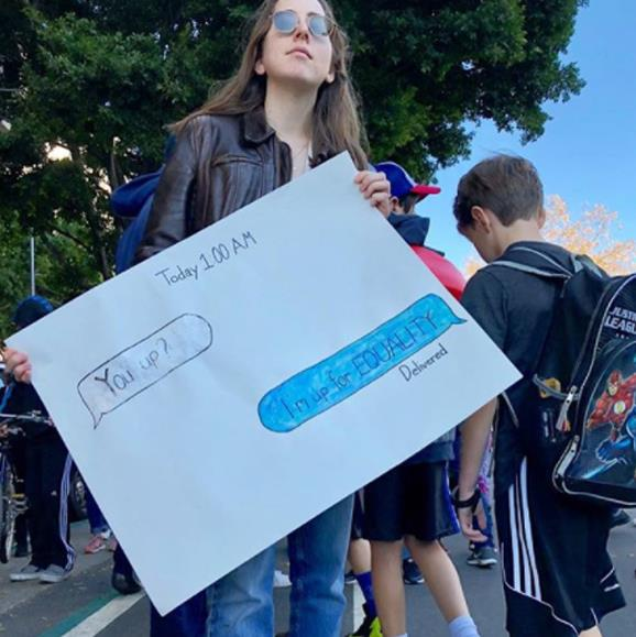 The youngest band member from girl rock group Haim made a perfectly millennial sign.