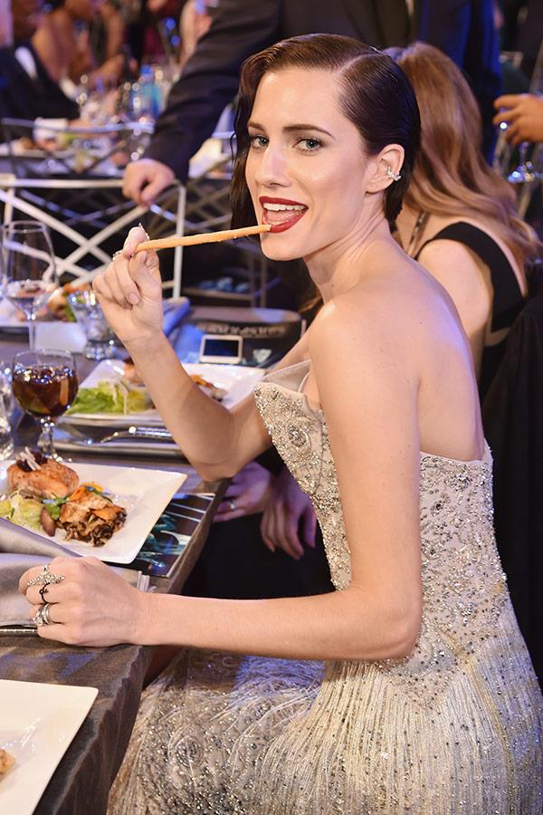 Allison Williams tucks into the cheese platter.