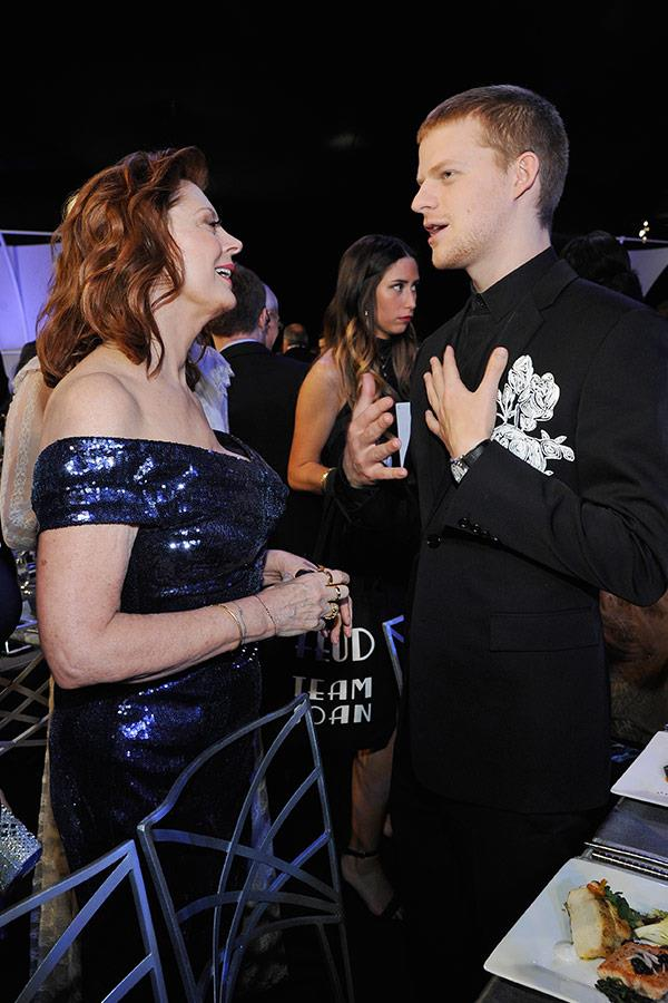 She's the life of the party! Susan Sarandon rubs shoulders with *Lady Bird*'s Lucas Hedges.