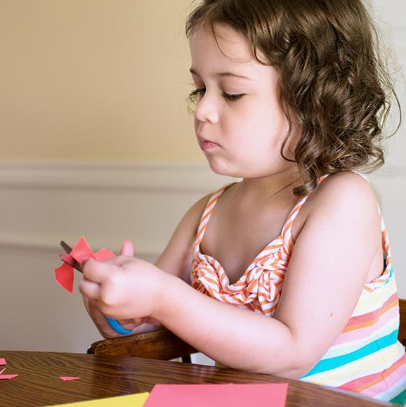 Children should have a space in the house where they can be creative using their imagination to draw and develop fine-motor skills by cutting with blunt scissors.