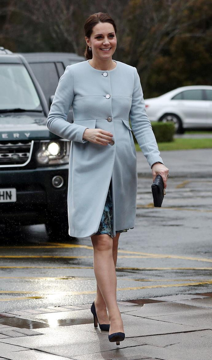 Duchess Catherine bumping her way through her always-long list of royal engagements in a dusty-blue button-up coat.