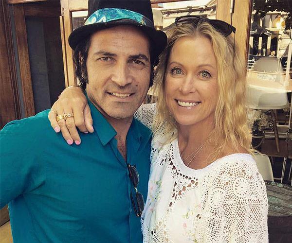 Lisa is engaged to Elvis impersonator Mark Tabone.