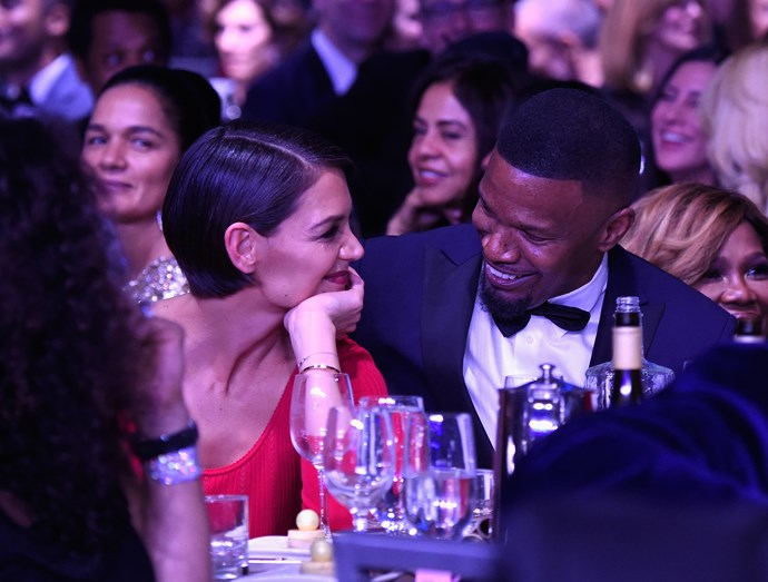 Katie and Jamie sharing a tender moment at Clive Davis' 2018 Grammys party.