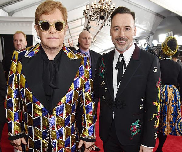 The musical legend was joined by his hubby, David Furnish.
