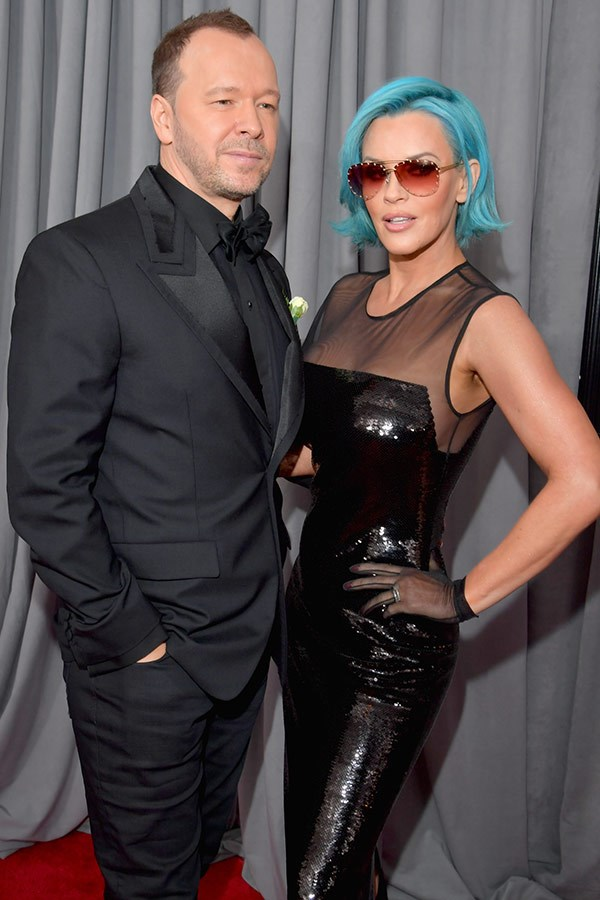 Jenny McCarthy is that you? The actress looks unrecognisable in a blue wig as she walks the red carpet with Donnie Wahlberg.