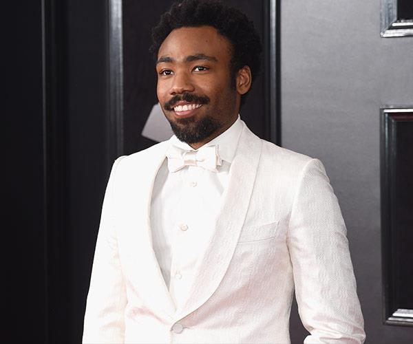 Childish Gambino is giving 90s' RnB chic with his all-white tux.