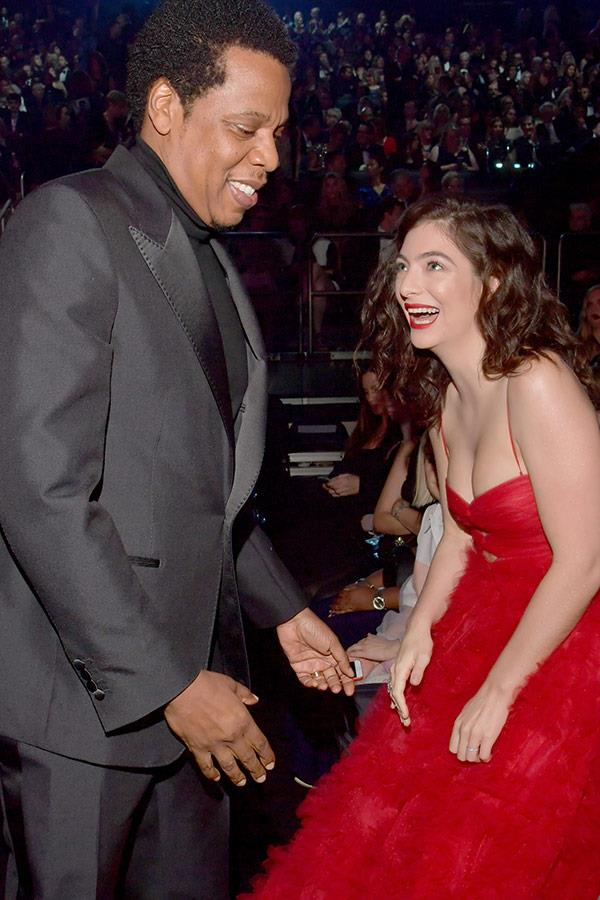 Jay Z and Lorde share a laugh.