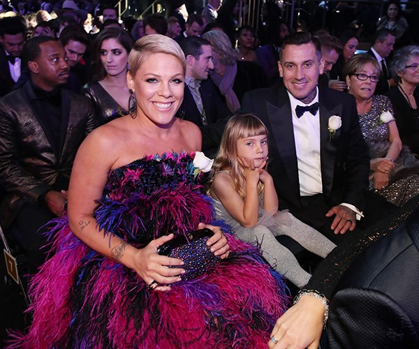 Pink's biggest fans! Her daughter and hubby.