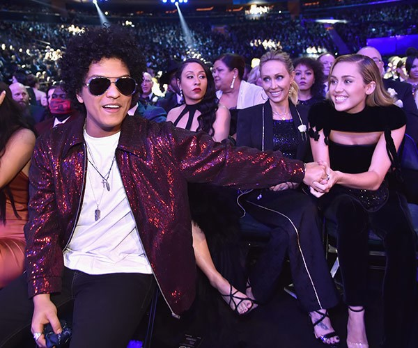 Bruno Mars and Miley Cyrus are thrilled to be reunited.